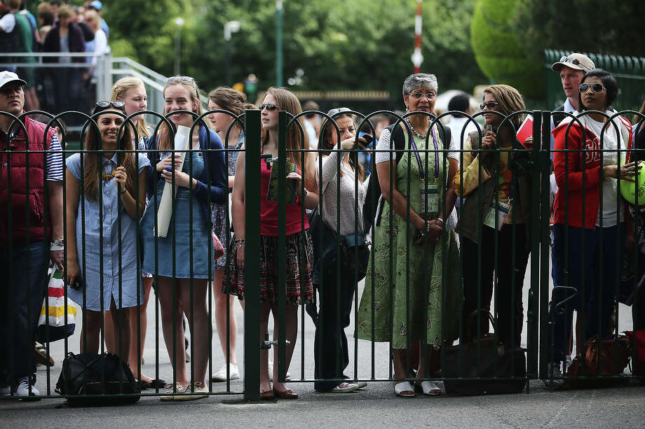 Tennis fans wait for autographs during day two of the Wimbledon Lawn Tennis Championships at the All England Lawn Tennis and Croquet Club on June 25, 2013 in London, England. Photo: Dan Kitwood, Getty Images / 2013 Getty Images
