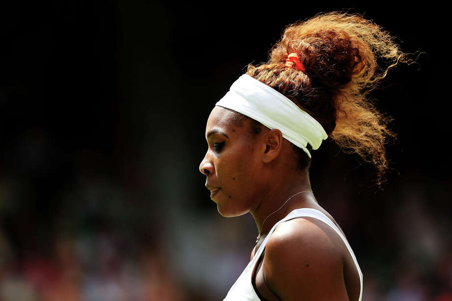 Serena Williams of the United States of America looks on during her Ladies' Singles first round match against Mandy Minella of Luxembourg on day two of the Wimbledon Lawn Tennis Championships at the All England Lawn Tennis and Croquet Club on June 25, 2013 in London. Photo: Julian Finney, Getty Images / 2013 Getty Images