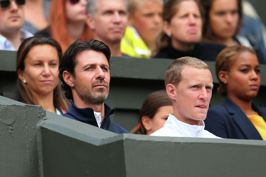 Patrick Mouratoglou (L), coach of Serena Williams of the United States of America watches her Ladies' Singes first round match against Mandy Minella of Luxembourg on day two of the Wimbledon Lawn Tennis Championships at the All England Lawn Tennis and Croquet Club on June 25, 2013 in London. Photo: Julian Finney, Getty Images / 2013 Getty Images