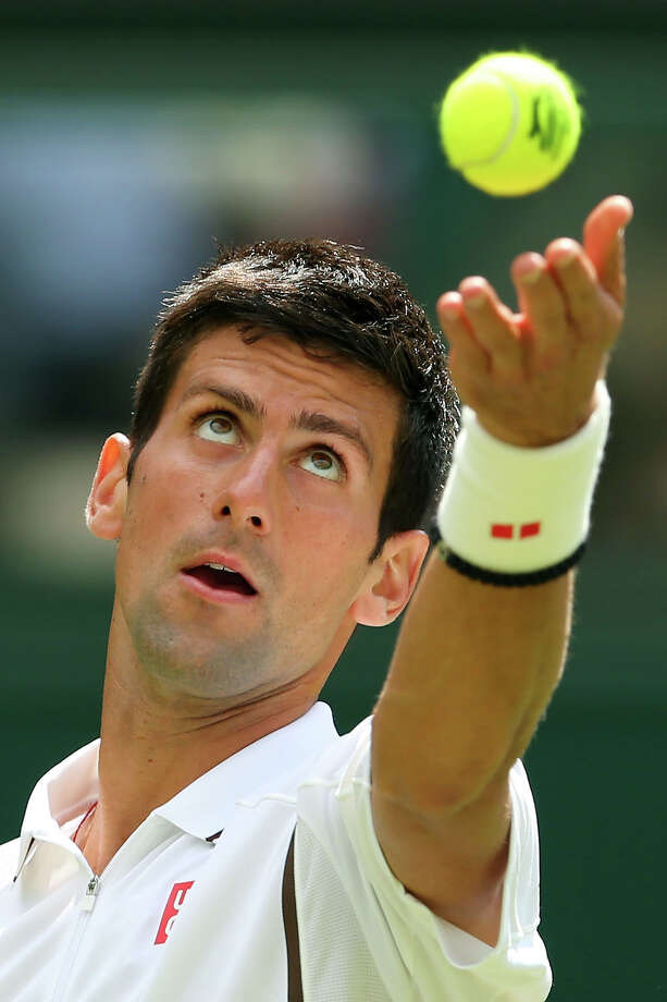 Novak Djokovic of Serbia tosses the ball in the air before serving during his Gentlemen's Singles first round match against Florian Mayer of Germany on day two of the Wimbledon Lawn Tennis Championships at the All England Lawn Tennis and Croquet Club on June 25, 2013 in London, England. Photo: Julian Finney, Getty Images / 2013 Getty Images