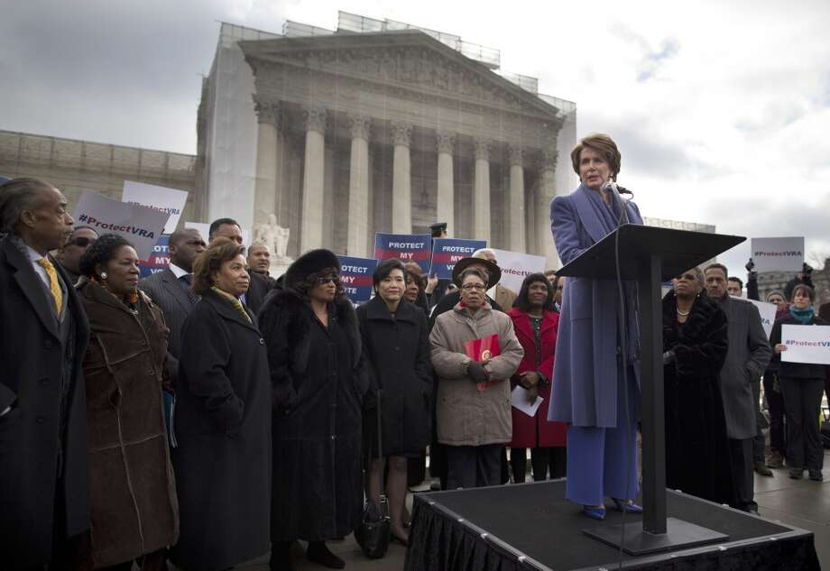 House Minority Leader Nancy Pelosi of Calif.,speaks during a rally outside the Supreme Court in Washington, Wednesday, Feb. 27, 2013, before arguments in the Shelby County, Ala., v. Holder voting rights case. The justices are hearing arguments in a challenge to the part of the Voting Rights Act that forces places with a history of discrimination, mainly in the Deep South, to get approval before they make any change in the way elections are held. (AP Photo/Evan Vucci) Photo: Evan Vucci, Associated Press