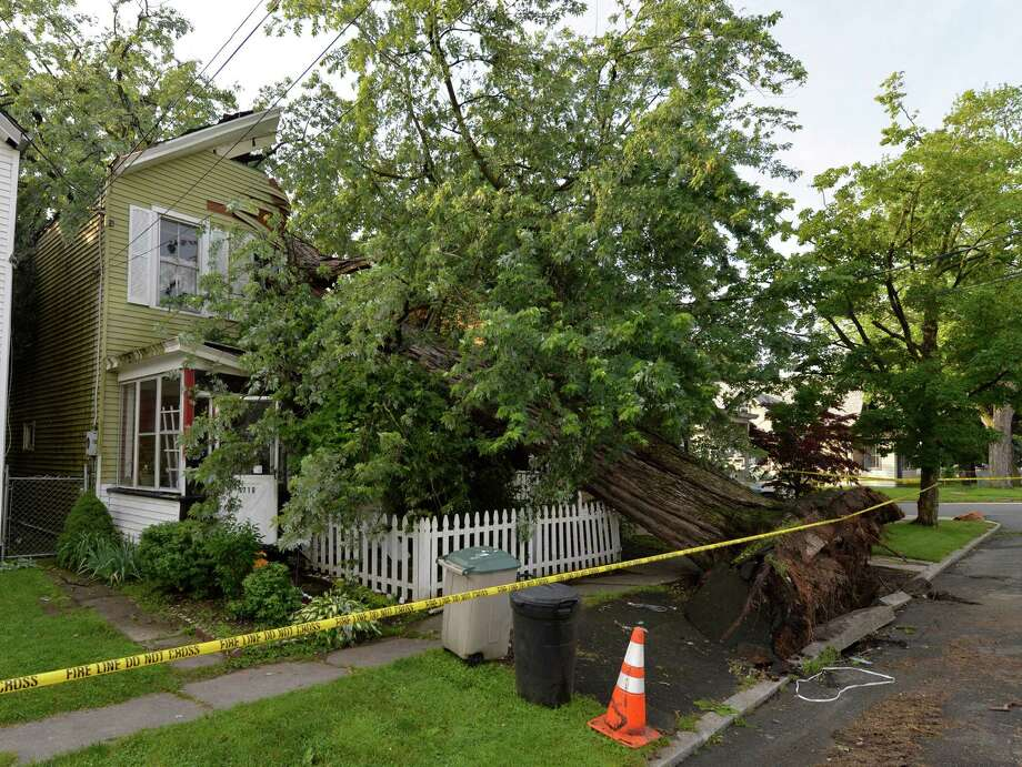 A very large tree hit and destroyed 1710 6th Street June 25, 2013 after a severe storm hit Rensselaer N.Y. last evening.   (Skip Dickstein/Times Union) Photo: SKIP DICKSTEIN