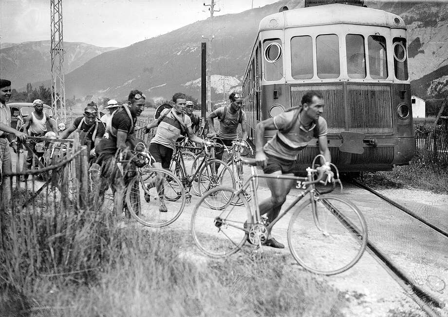 1937: Roger Lapebie, right, crossing rail tracks during the Tour de France. Photo: Roger Viollet, Roger Viollet/Getty Images / 2007 Roger Viollet