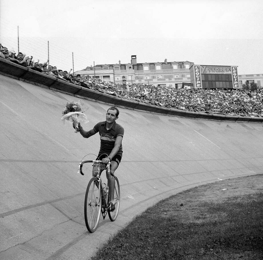1938: Italian racing cyclist Gino Bartali cycling round the velodrome at the Parc des Princes after winning the 1938 Tour de France. Photo: Roger Viollet, Roger Viollet/Getty Images / 2007 Roger Viollet