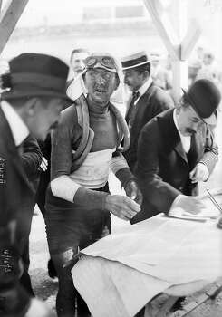 1909: French racing cyclist Jean Alavoine signing the checking sheet during the Tour de France. Photo: Roger Viollet, Roger Viollet/Getty Images / 2007 Roger Viollet