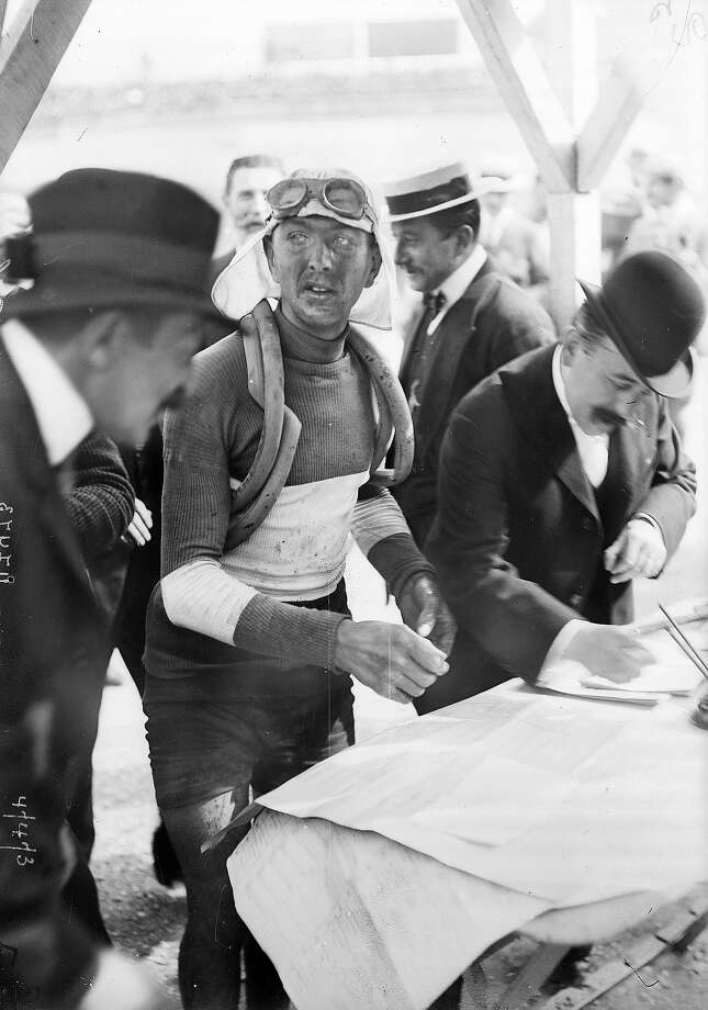 1909:French racing cyclist Jean Alavoine signing the checking sheet during the Tour de France. Photo: Roger Viollet, Roger Viollet/Getty Images / 2007 Roger Viollet