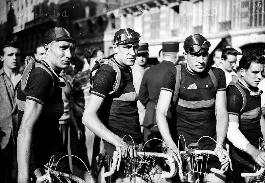 1947: Depredomme, Gysselinck and Mathieu, Belgian racing cyclists. Photo: Roger Viollet, Roger Viollet/Getty Images / Roger Viollet