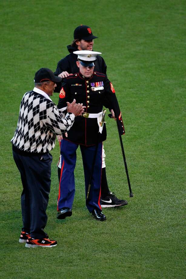 Willie Mays, Afghanistan war vet and triple amputee Marine Cpl. Nicholas Kimmel and Barry Zito are seen during pre-game ceremonies prior to Game 2 of the World Series at AT&T Park on Thursday, Oct. 25, 2012 in San Francisco, Calif. Photo: Beck Diefenbach, Special To The Chronicle / ONLINE_YES