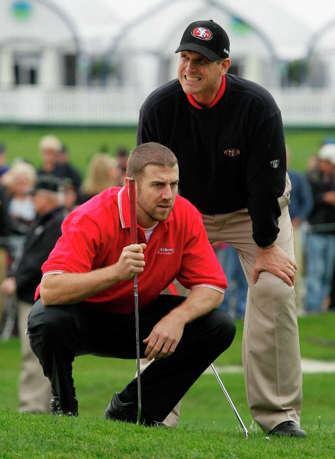 Jim Harbaugh can make even charity events look intense. Here, former 49ers QB Alex Smith and coach wait to putt on the third green during a charity shootout between the 49ers and the San Francisco Giants at the AT&T Pebble Beach National Pro-Am golf tournament in Pebble Beach, Calif.,Tuesday, Feb. 7, 2012.  Photo: Eric Risberg, Associated Press / AP