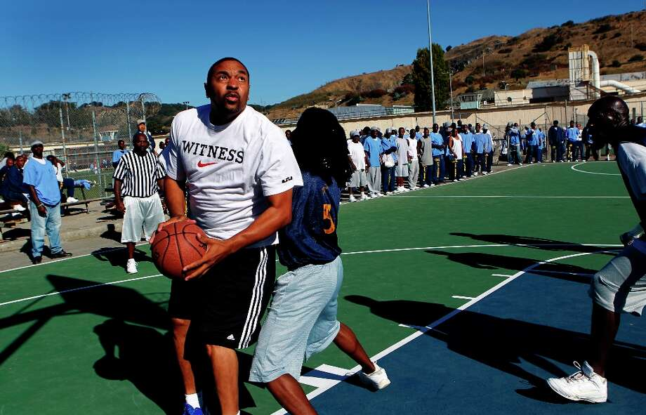Some of the Golden State Warriors have made a tradition of visiting inmates at San Quentin State Prison. Here, head coach Mark Jackson drives for a layup past Ishmel Auxila-Pierrelouis in a basketball game against inmates on Saturday, Sept. 22, 2012. Photo: Paul Chinn, The Chronicle / ONLINE_YES