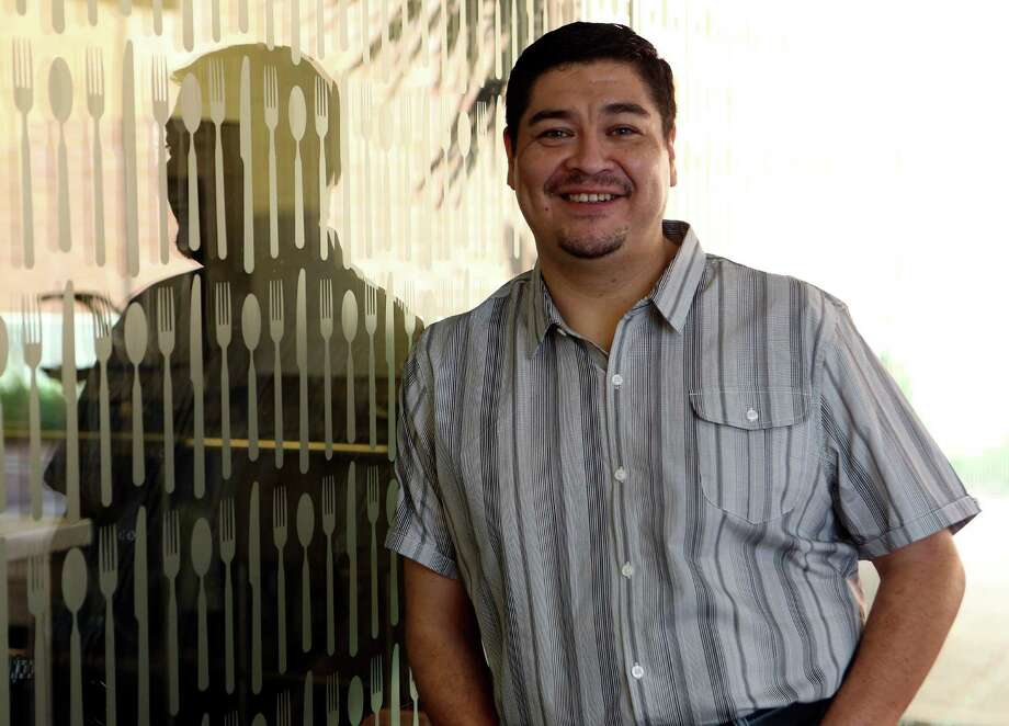 Johnny Rodriguez, a chef who attended the CIA, now works for John Besh at the American Sector. Photo: Helen L. Montoya, San Antonio Express-News / ©2013 San Antonio Express-News
