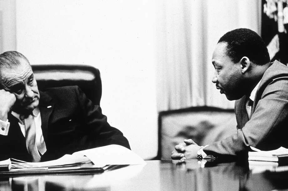 President Lyndon B Johnson (1908 - 1973) discusses the Voting Rights Act with civil rights campaigner Martin Luther King Jr. (1929 - 1968). The act, part of President Johnson's 'Great Society' program trebled the number of black voters in the south, who had previously been hindered by racially inspired laws, 1965. Photo: Hulton Archive, Getty Images / 2003 Getty Images