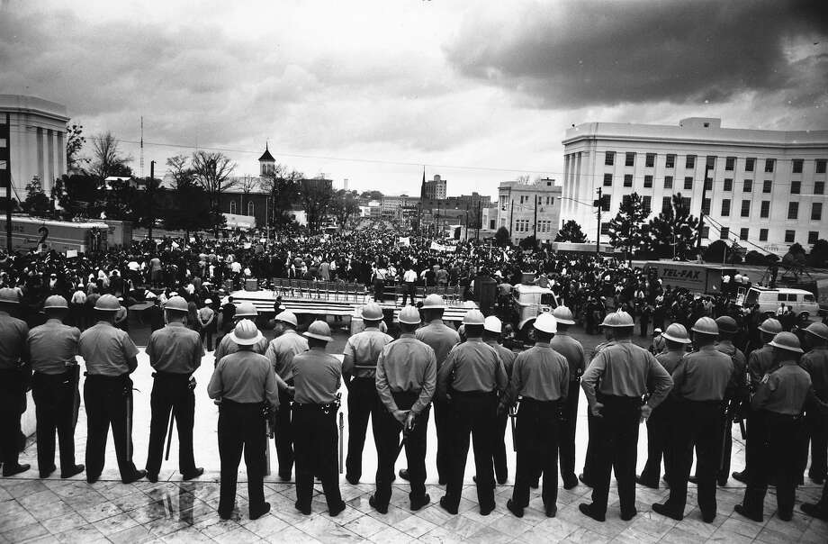 A line of policemen on duty during a black voting rights march in Montgomery, Alabama. Dr. Martin Luther King, Jr. led the march from Selma, Alabama, to the state capital in Montgomery. Photo: William Lovelace, Getty Images / Hulton Archive