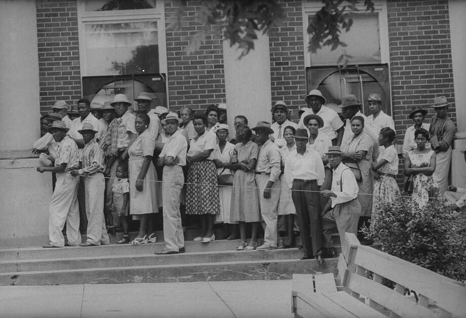 African Americans waiting to register for voting despite threat of reprisals. Photo: Walter Sanders, Time & Life Pictures/Getty Image / Time Life Pictures