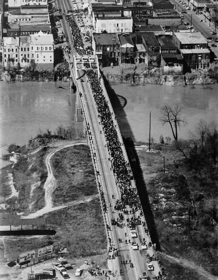 This aerial view shows a half-mile-long column of civil rights demonstrators, led by Dr Martin Luther King, on March 21, 1965 in Selma, Alabama, as they cross the Edmund Pettus bridge, scene of recent confrontation between demonstrators and state troopers, on the third leg of the Selma to Montgomery marches. Police attacked civil-rights marchers outside Selma, Alabama, on Bloody Sunday, March 7, 1965. The Selma-to-Montgomery March for voting rights ended three weeks and represented the political and emotional peak of the modern civil rights movement. Photo: AFP, AFP/Getty Images / 2009 AFP