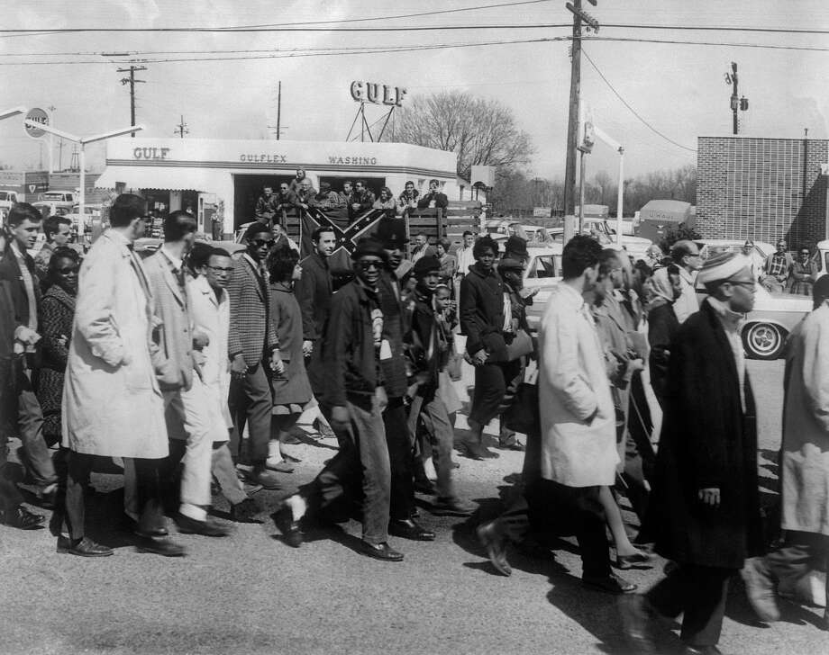 "Civil rights demonstrators, led by Dr Martin Luther King, make their way from Selma to Montgomery on March 21, 1965 in Alabama, on the third leg of the Selma to Montgomery marches. The Selma-to-Montgomery March for voting rights ended three weeks and represented the political and emotional peak of the modern civil rights movement. The first march took place on March 07, 1965 (""Bloody Sunday"") when 600 civil rights marchers were attacked by state and local police. Photo: AFP, AFP/Getty Images / 2009 AFP"