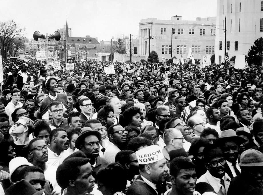 "The march from Selma to Montgomery was a civil rights event leading up to the Voting Rights Act of 1965, part of which was rejected today by the Supreme Court. Here is a look back at the march:Civil rights demonstrators, led by Dr Martin Luther King (not pictured), arrive in Montgomery from Selma on March 26, 1965 in Alabama, on the third leg of the Selma to Montgomery marches. The Selma-to-Montgomery March for voting rights ended three weeks and represented the political and emotional peak of the modern civil rights movement. The first march took place on March 07, 1965 (""Bloody Sunday"") when 600 civil rights marchers were attacked by state and local police. Photo: AFP, AFP/Getty Images / 2009 AFP"