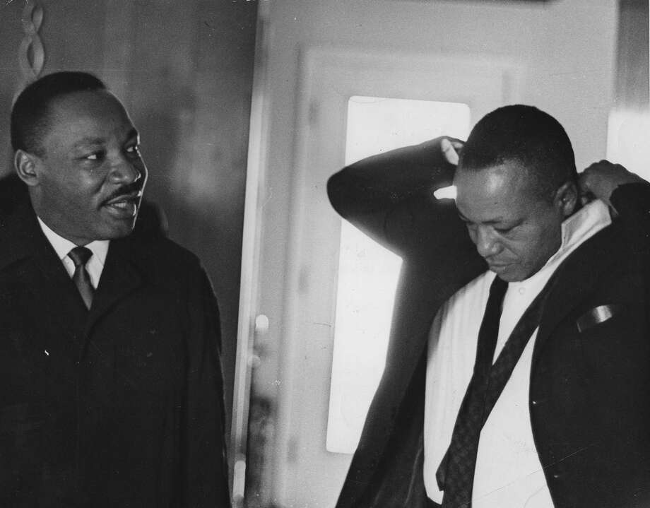 Dr. Martin Luther King, Jr. (1929 - 1968) talking with Chicago Defender Publisher John Henry Sengstacke (1912 - 1997) at the home where Dr. King spent the night in Montgomery, Alabama prior to the final day of the Selma to Montgomery march, 1965. From the Chicago Defender Collection. Photo: Robert Abbott Sengstacke, Getty Images / Archive Photos