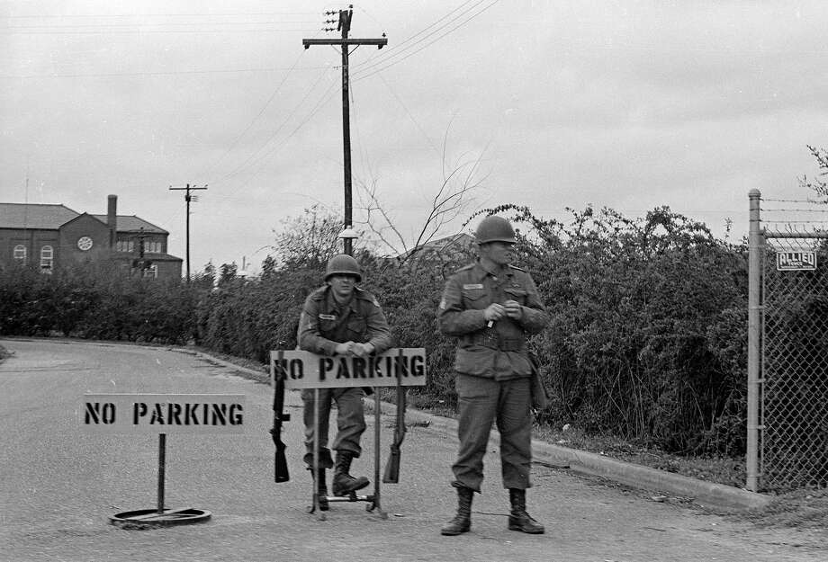 Armed National Guardsmen stand along the route, on the penultimate day of the Montgomery civil rights march, March 1965. Photo: Robert Abbott Sengstacke, Getty Images / © Robert A. Sengstascke 1988