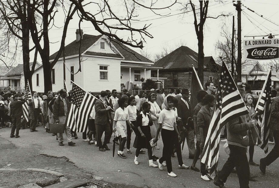 Participants, some carrying American flags, marching in the civil rights march from Selma to Montgomery. Photo: UniversalImagesGroup, Getty Images / Universal Images Group Editorial