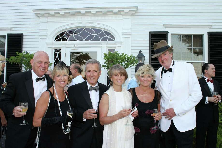 "Mark and Vicki Smith, Rocco and Netta D'Angelo and Sandi and Jim Duffy, all of Darien, from left, enjoy the glitz and glamour of the Jazz Age at Family Centers' ""Gatsby on the Sound: benefit in Greenwich. Photo: Contributed"