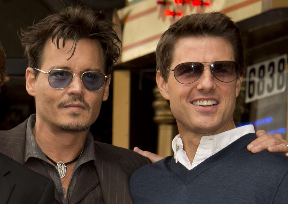 Actors Johnny Depp (L) and Tom Cruise attend a ceremony honoring producer Jerry Bruckheimer with the 2,501st star on the Hollywood Walk of Fame, in front of El Capitan Theatre in Hollywood,  California June 24, 2013.  AFP PHOTO / ROBYN BECK        (Photo credit should read ROBYN BECK/AFP/Getty Images)
