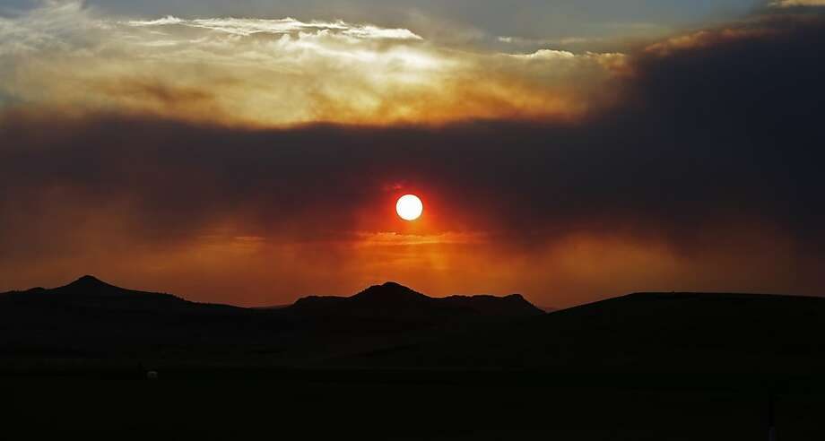 Smoke shroudsthe sunset near Monte Vista, Colo. A large wildfire near a popular 