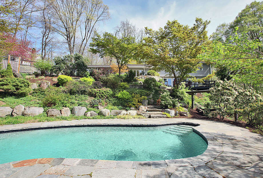 The house at 7 Hawthorne Lane, overlooking the pool on its multi-level property, is on the market for $1.649 million. Photo: Contributed Photo / Westport News