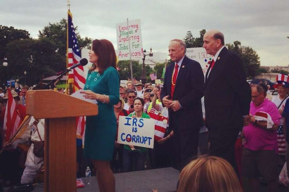 Rep. Louie Gohmert of Tyler stands by as Minnesota Rep. Michele Bachmann speaks at a Tea Party event in Washington on June 19, 2013. Rep. Steve King of Iowa is pictured at center. (Twitter photo)