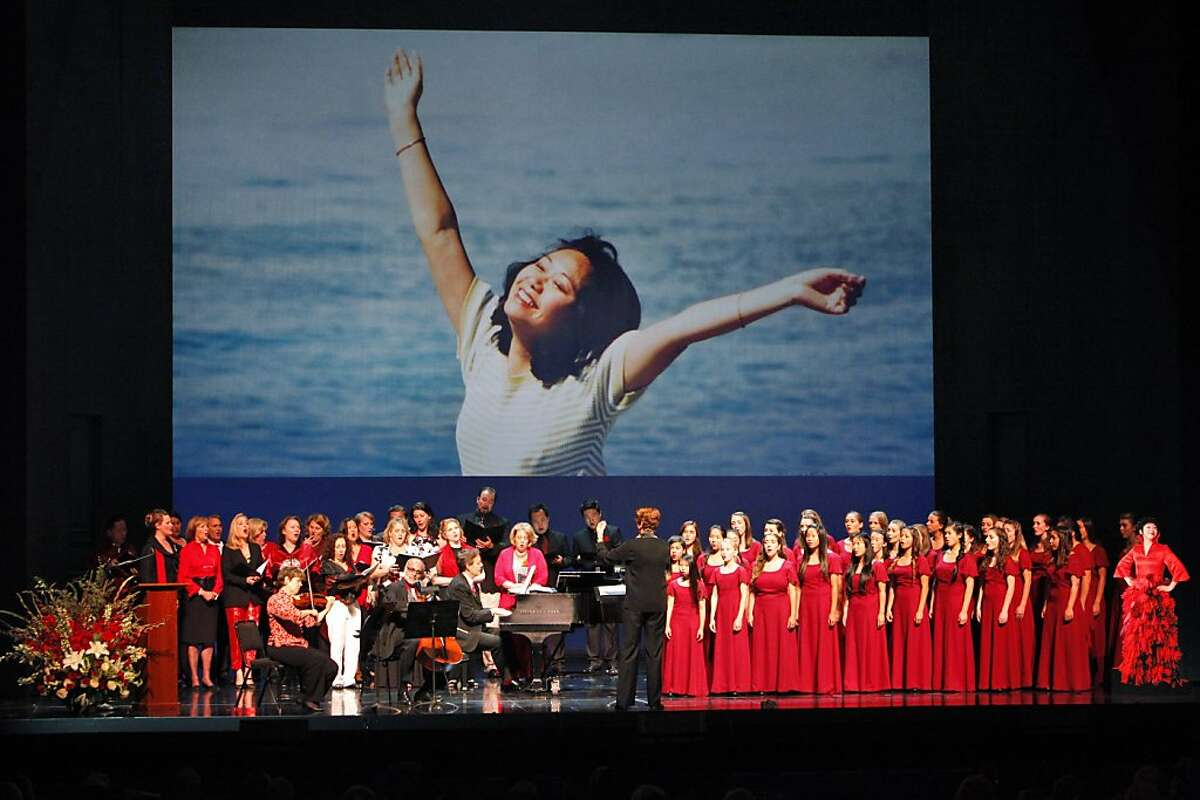 """Friends and fellow performers sing """"Somewhere Over the Rainbow,"""" at the War Memorial Opera House during a memorial concert for Zheng Cao on Monday, June 24, 2013, in San Francisco, Calif. The Chinese-born mezzo soprano died this year after a long struggle with cancer."""