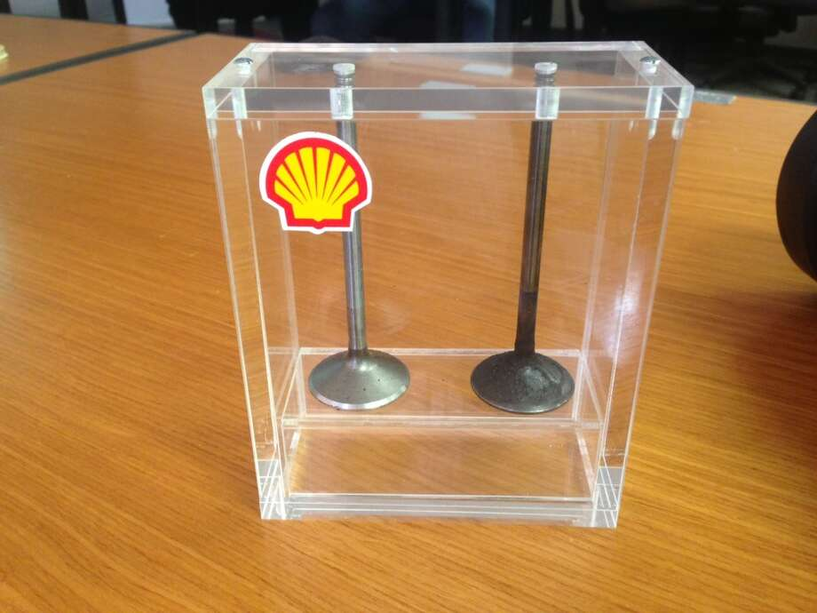 Automotive engine intake and exhaust valves are displayed at the Shell Technology Center in Houston, where the company tests its specialty fuels and engine performance.
