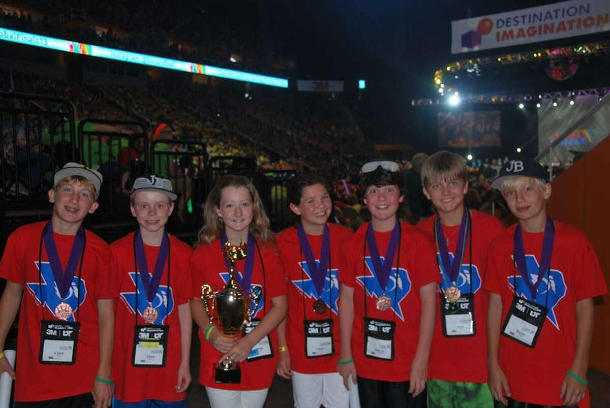 """Fifth-graders Caleb Young (left to right), Adam Parker, Josie McGarraugh, Claire Gunter, McCoy Patterson, Jack Seager and Hayes Ulm were part of Woodridge Elementary School's """"Full Force"""" team in the Destination ImagiNation Global Finals in Knoxville, Tenn. They competed in the """"Twist-O-Rama"""" challenge."""