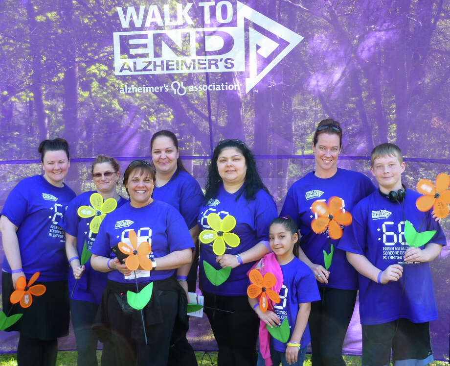 Bringing smiles, one and all, were members of the team called Cure 4 Sure, from left to right, Amber MacDonald, Susan Duff, Rosa Carlesio, Carolyn Lokis, Mary Lokis, Abrigail Santiago, Cheryl Allen and Donovan Allen, to the Walk To End Alzheimer's, offered May 4, 2013 at Harrybrooke Park in New Milford.  Courtesy of the Alzheimer's Association Photo: Contributed Photo