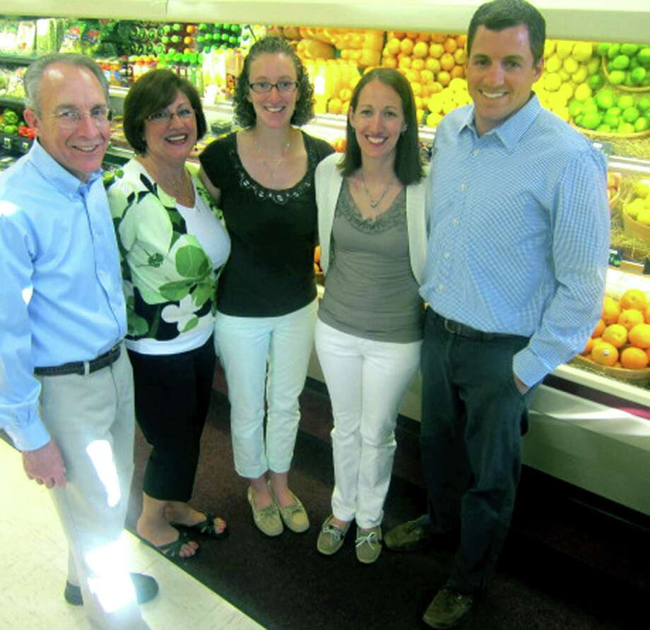 George and Jocelyne Verrastro have teamed to operate the Washington Food Market with lots of help from their daughters, Michelle Mott, center, and Lisa Stein, and son Mark Verrastro. June 2013 Photo: Norm Cummings