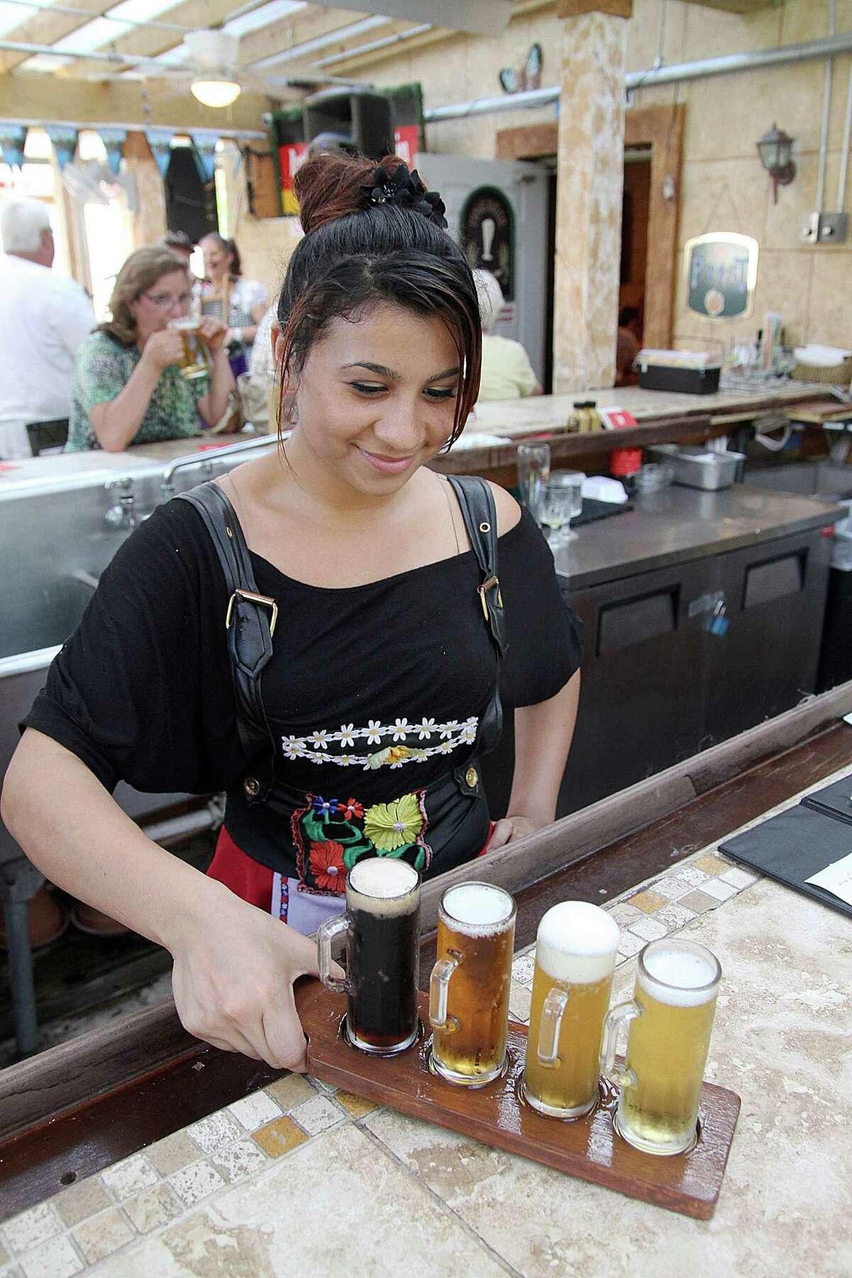 Jeannete Carado showcases a Beer Tour Sampler at King's Biergarten and Restaurant. Jeannete Carado showcases a Beer Tour Sampler at King's Biergarten and Restaurant.