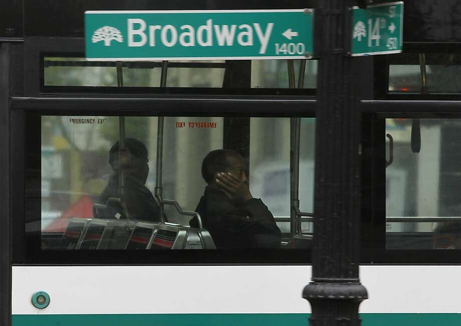 In this file photo, passengers ride an inbound AC Transit bus in downtown Oakland. AC Transit employees and management avoided a potential strike by coming to an agreement on a three year contract late last night. Photo: Paul Chinn, The Chronicle