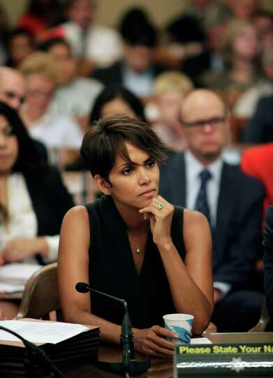 Actress Halle Berry listens to questions as she testifies before the Assembly Committee on Public Sa