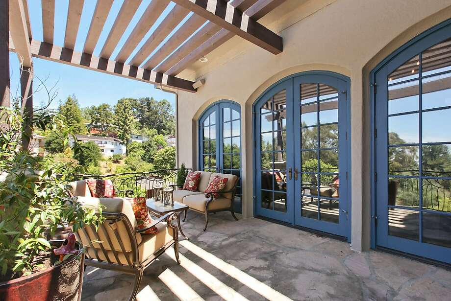 Three sets of French doors connect the terrace to the living room. Photo: OpenHomesPhotography.com