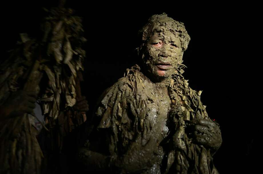 Blessed are the muddy: In Luzon, Philippines, Christian Taong Putik (mud people) walk to Mass at 