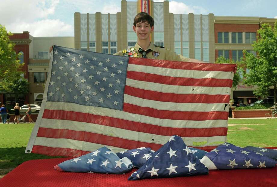 The Woodlands Boy Scout Al Shaffer, 14, a freshman at The Woodlands College Park Academy of Science & Technology, is coordinating Scouts from several troops to collect old flags during the Fourth of July parade in The Woodlands. Photo: Jerry Baker, Freelance