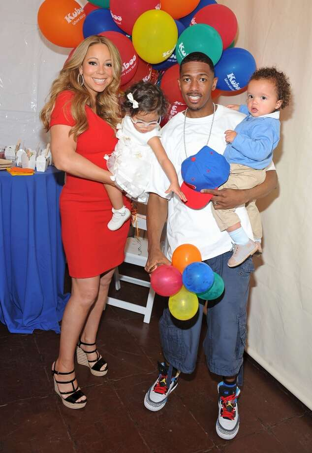 Singer Mariah Carey and TV personality Nick Cannon pose for pictures with their twins Monroe Cannon and Moroccan Scott Cannon during 'Family Day' at Santa Monica Pier on October 6, 2012 in Santa Monica, California.  (Photo by Angela Weiss/WireImage)