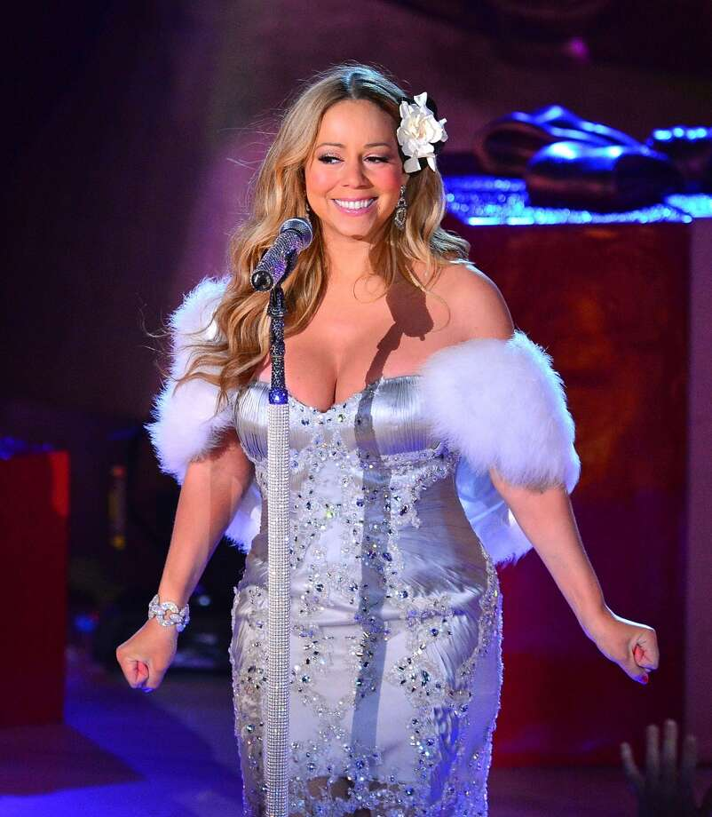 Mariah Carey sings during a pre-tape performance for NBC's Christmas tree lighting at Rockefeller Center on November 27, 2012 in New York City.  (Photo by James Devaney/WireImage)