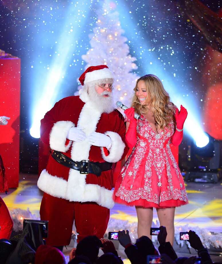 Mariah Carey sings during a pre-tape performance for NBC's Christmas tree lighting at Rockefeller Center on November 27, 2012 in New York City.  (Photo by James Devaney/FilmMagic)