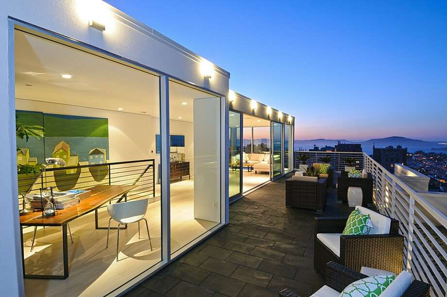 The Pacific Heights condominium overlooks San Francisco and features floor-to-ceiling windows. Photo: Jennifer Salyers