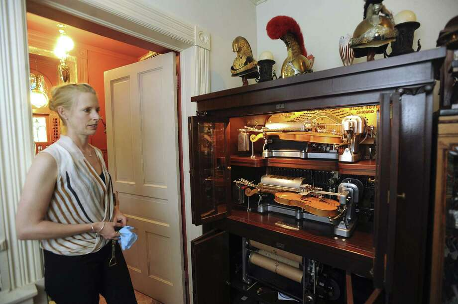 Meg Nowack explains the workings of this violano virtuoso in Villa Finale, the former home of preservationist Walter Mathis. Photo: Billy Calzada / San Antonio Express-News