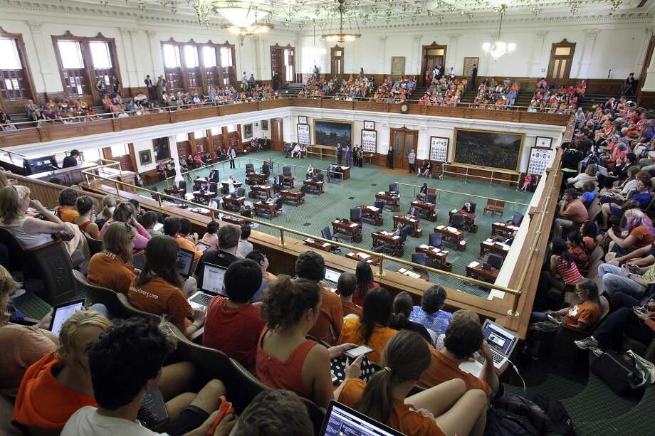 Spectators watch from the balcony as Fort Worth Senator Wendy Davis filibusters in an effort to cause abortion legislation to die without a vote on the floor of the Senate Tuesday, June 25, 2013. Photo: TOM REEL, San Antonio Express-News