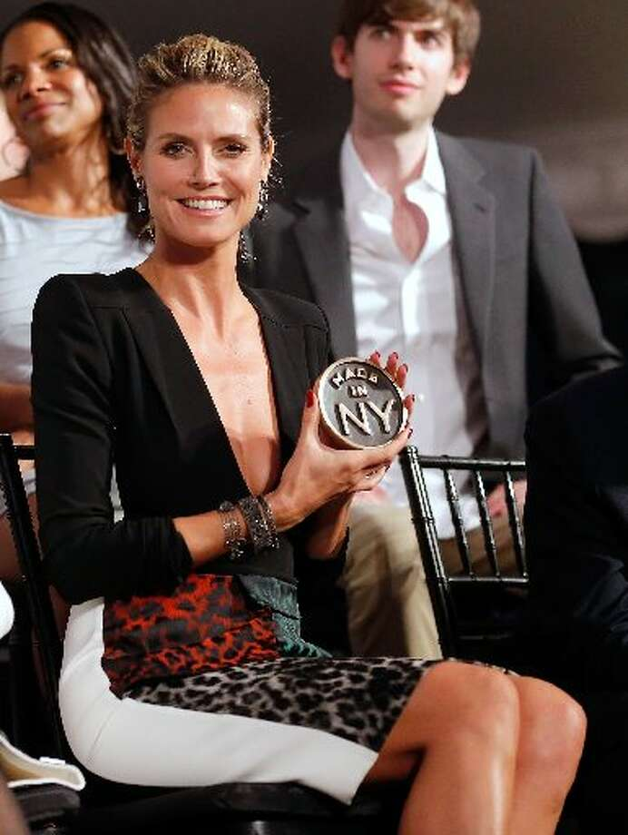 Heidi Klum is the latest to get an ex-related tattoo removed as she is getting rid of her Seal ink. Photo: Getty