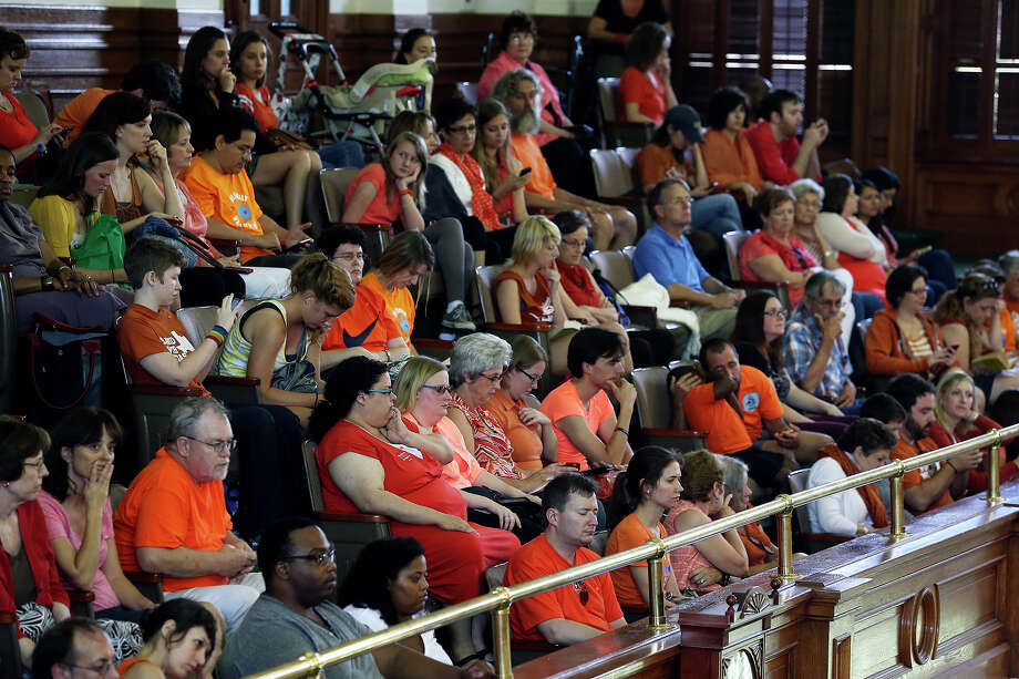 Spectators watch from the balcony as Fort Worth Senator Wendy Davis filibusters in an effort to cause abortion legislation to die without a vote on the floor of the Senate Tuesday, June 25, 2013. Photo: TOM REEL