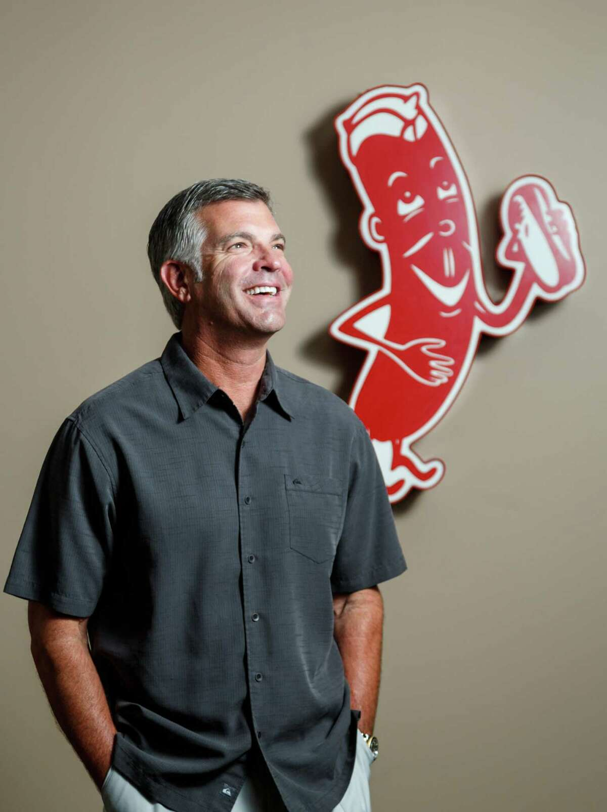 James Coney Island CEO Darrin Straughan poses for a photo at the restaurants' headquarters, Tuesday, June 18, 2013, in Houston. James Coney Island is celebrating its 90th anniversary this year and will soon announce several new concepts that will include more upscale restaurants modernizing the born-in-Houston hot dog chain. ( Michael Paulsen / Houston Chronicle )
