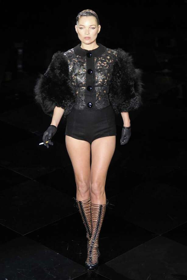 Kate Moss shows off her boots on the runway. Good thing she's got gloves on. Otherwise she might get cold. Photo: Antonio De Moraes Barros Filho, WireImage / 2011 Antonio de Moraes Barros Filho